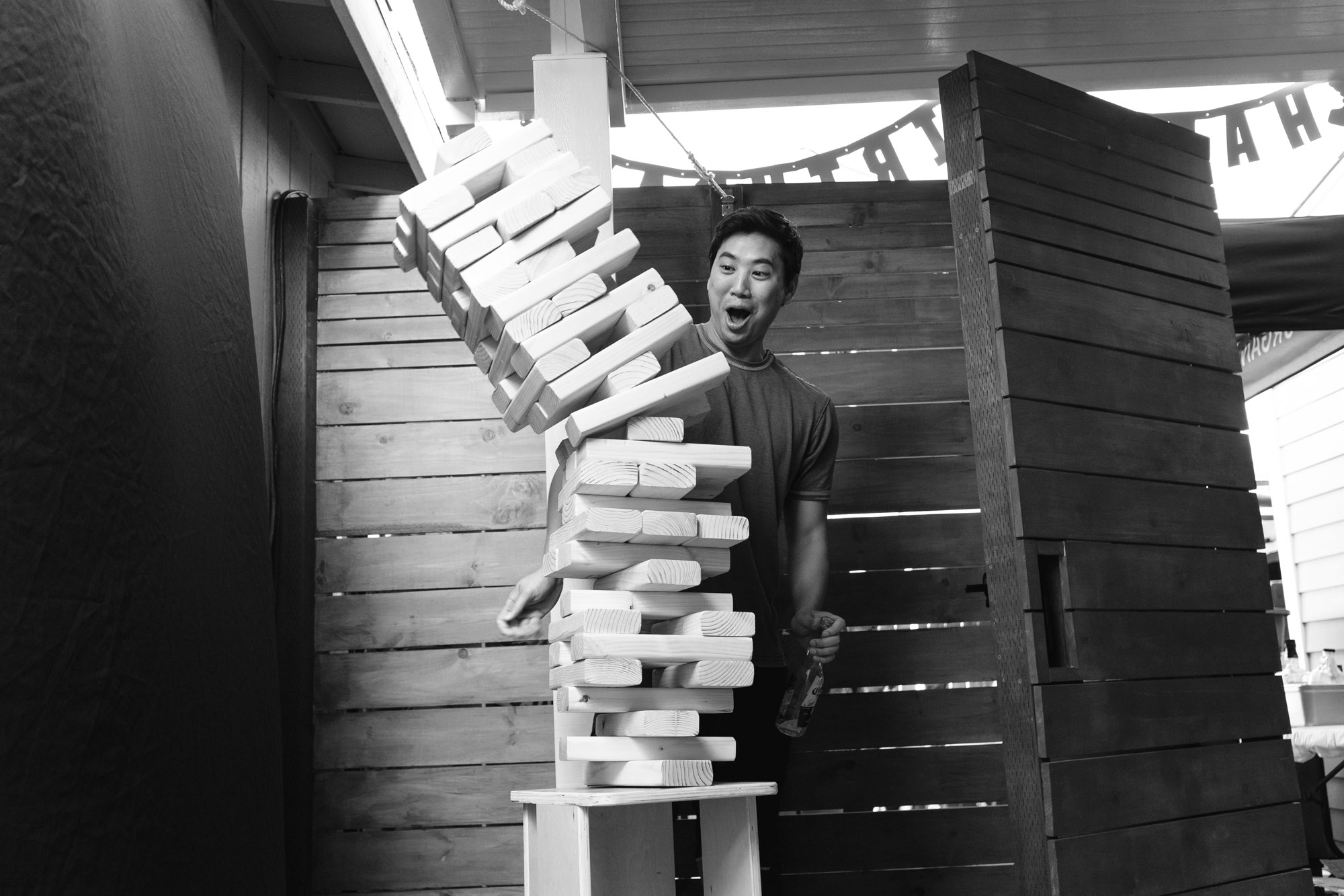 John watching a huge jenga tower fall over.