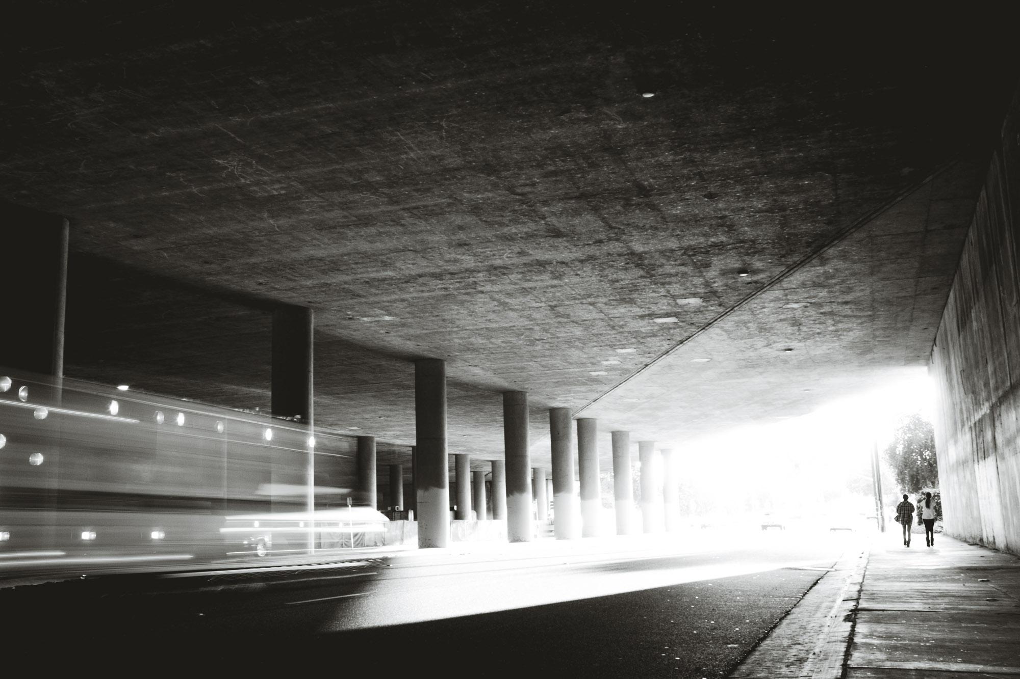 People walking under the freeway in Long Beach.