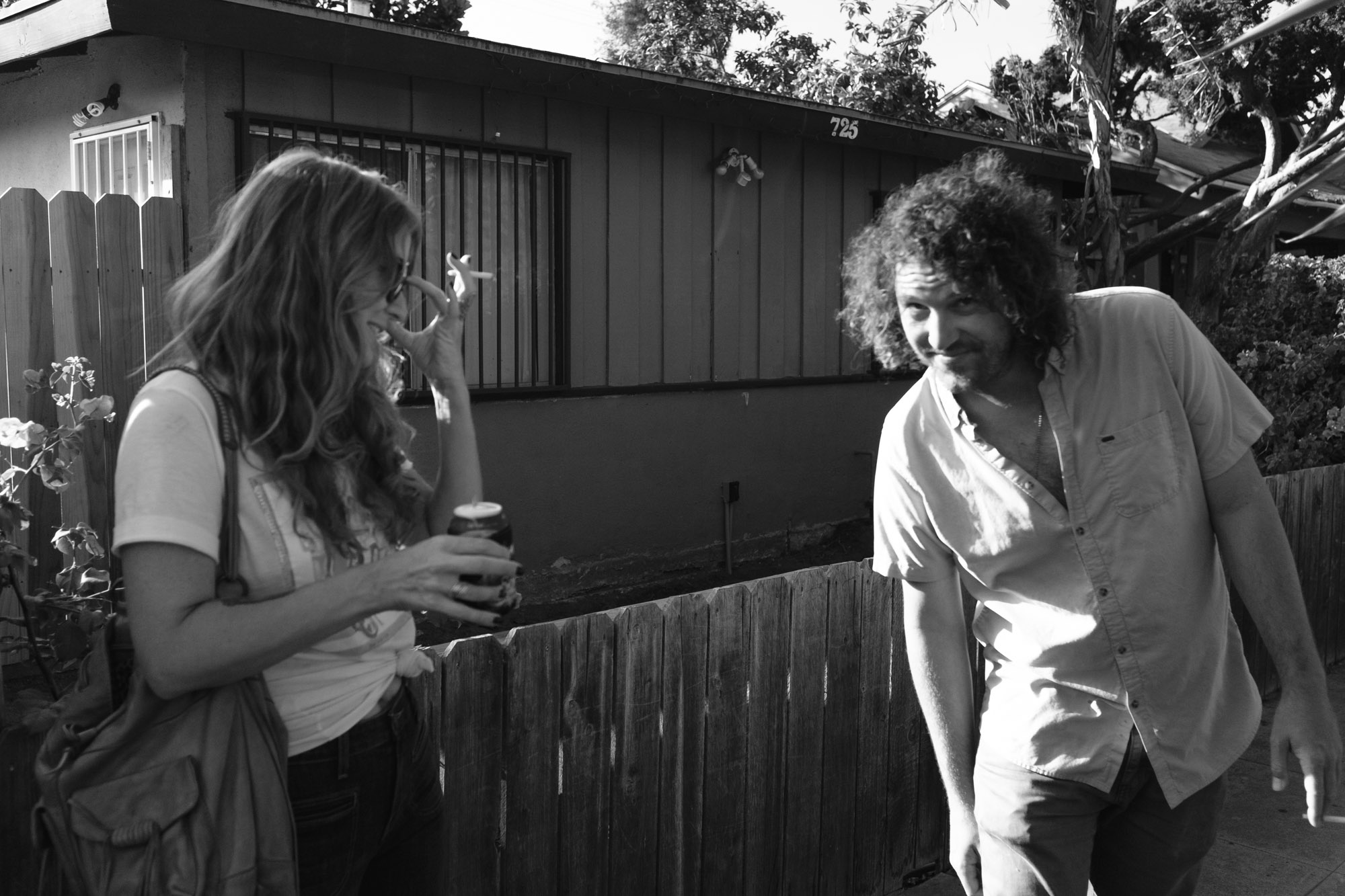 Mikey and Amelie smoking outside in Long Beach.
