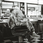Jack cutting an older clients hair at A Barber Shop in Long Beach, CA.