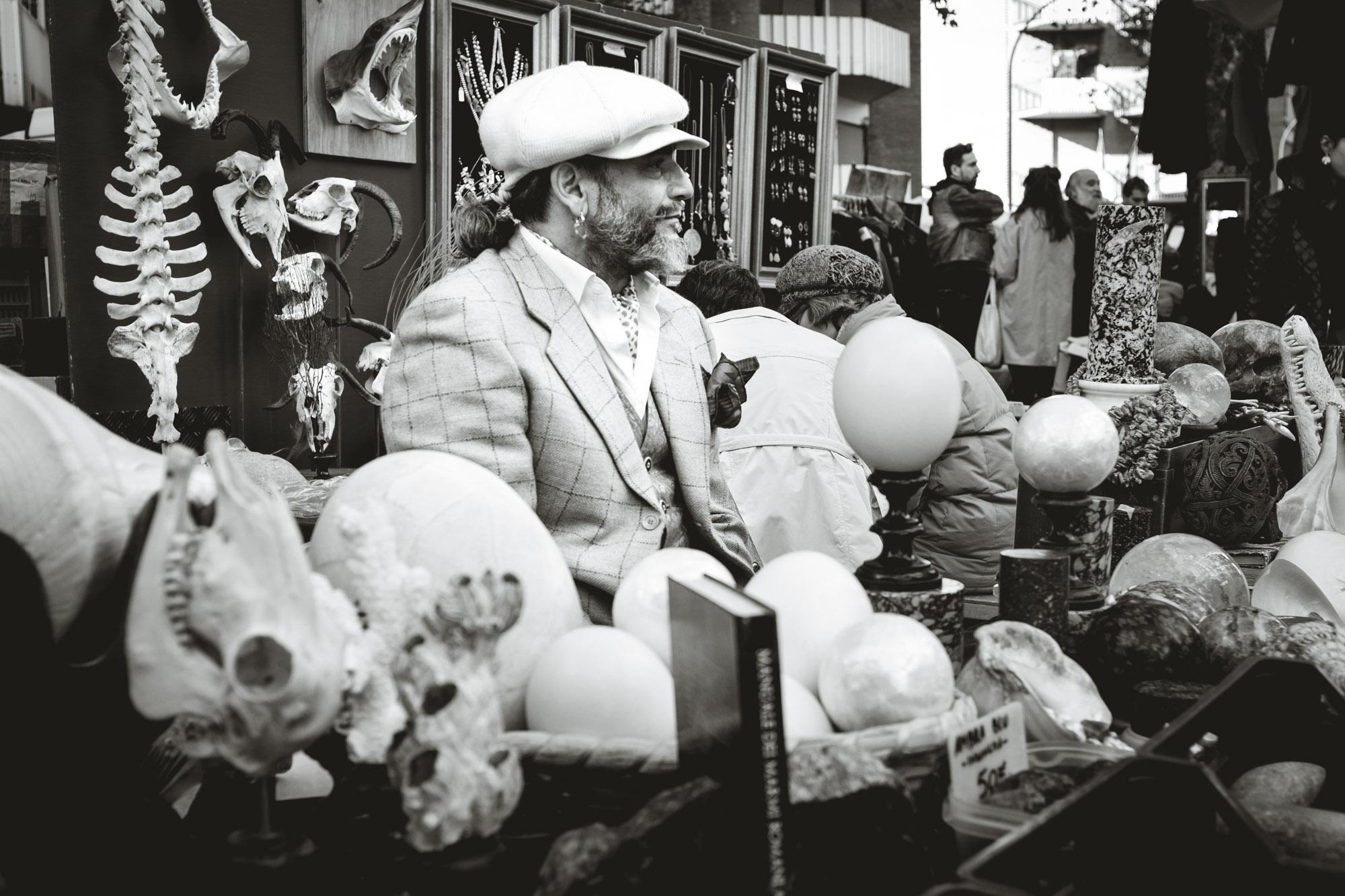 Man selling skulls in Porta Portese Rome