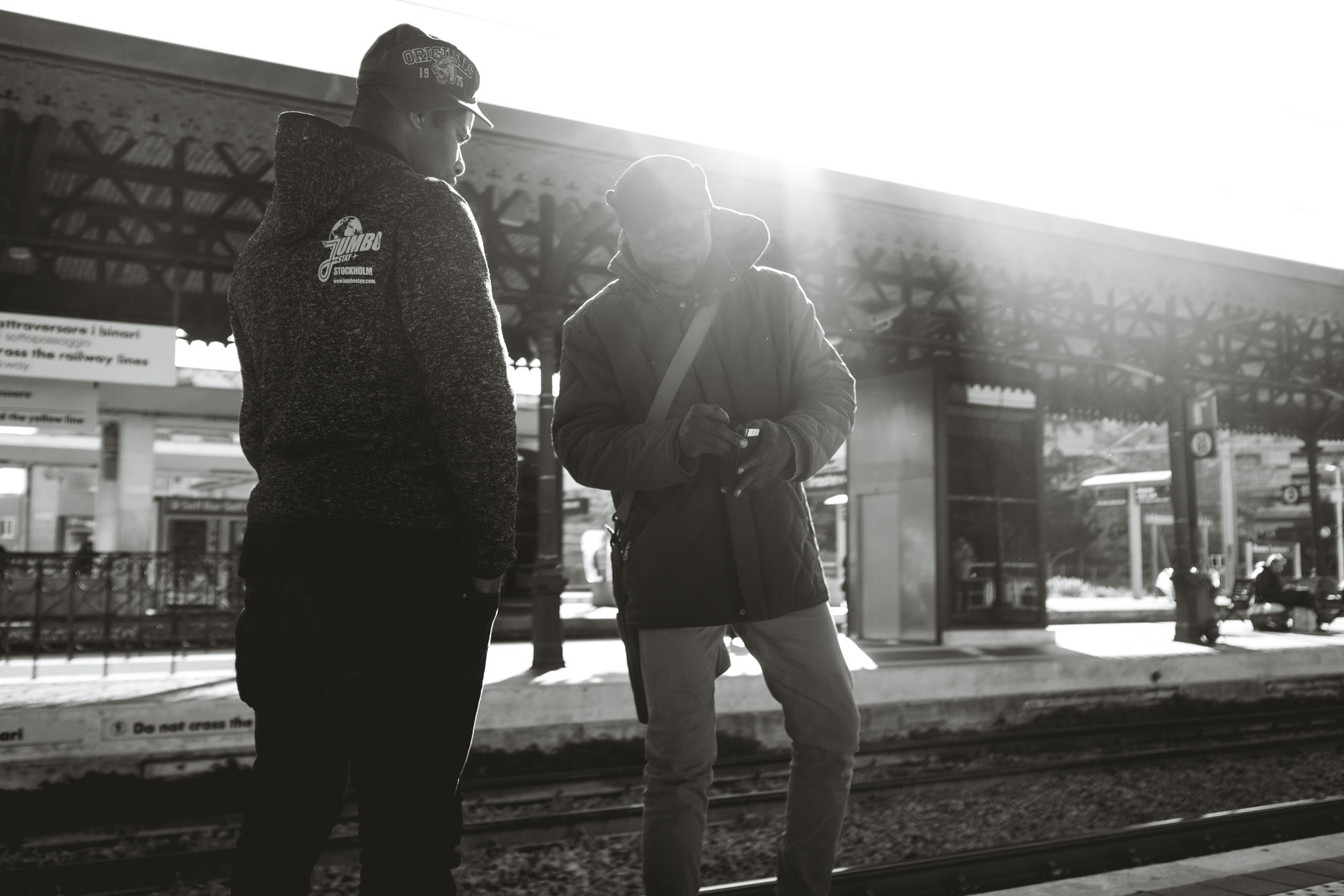 Two men exchage money at train station in Trastevere Rome