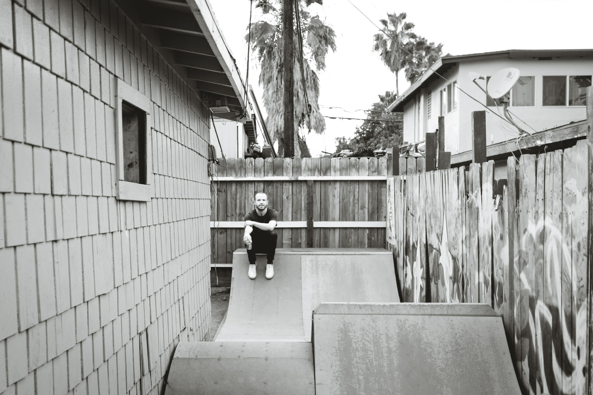 Cory sits on his ramp in his backyard.