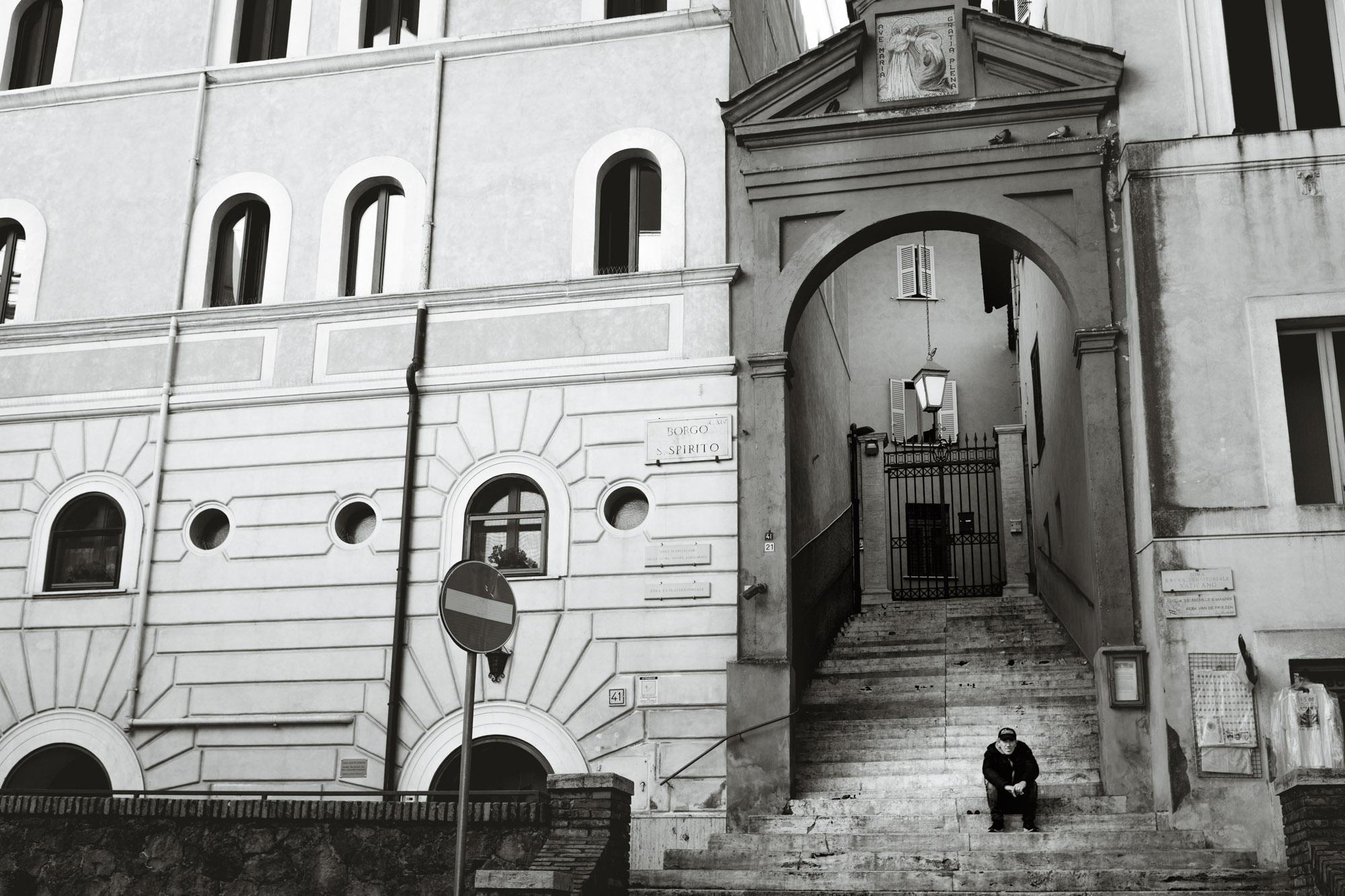 Man sitting on stoop near Vatican City