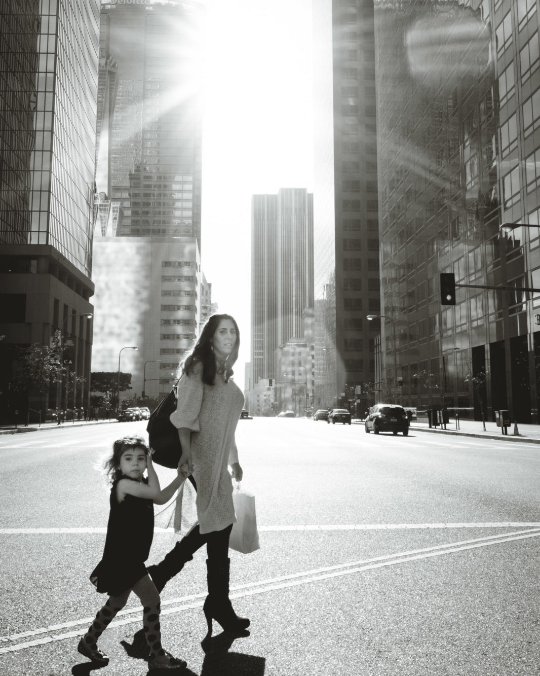 Woman and daughter crossing the street in Los Angeles