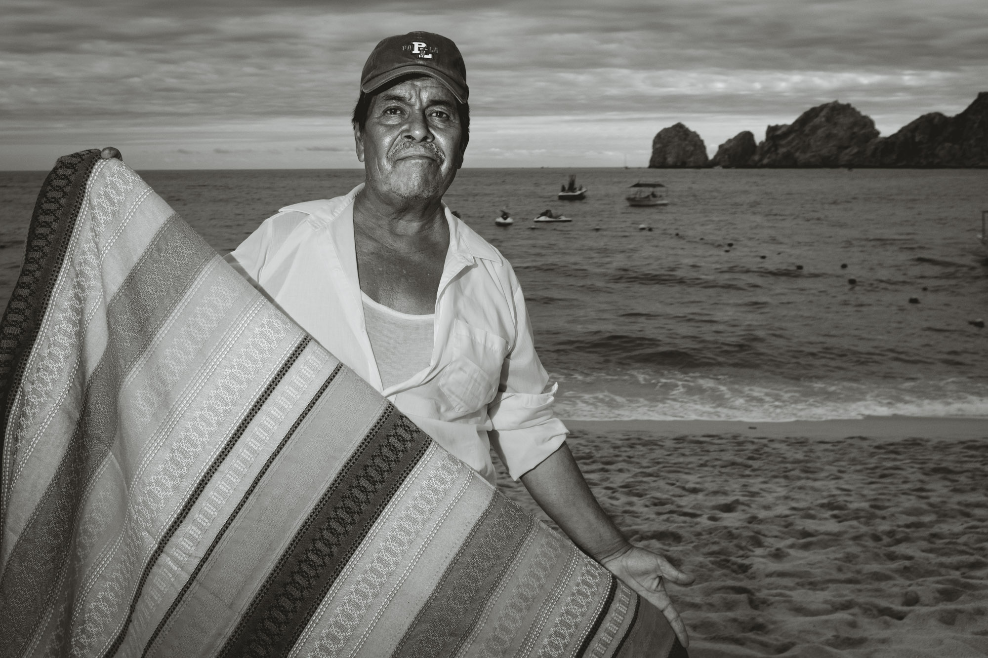 Portrait of a blanket vendor on the beach in cabo san lucas
