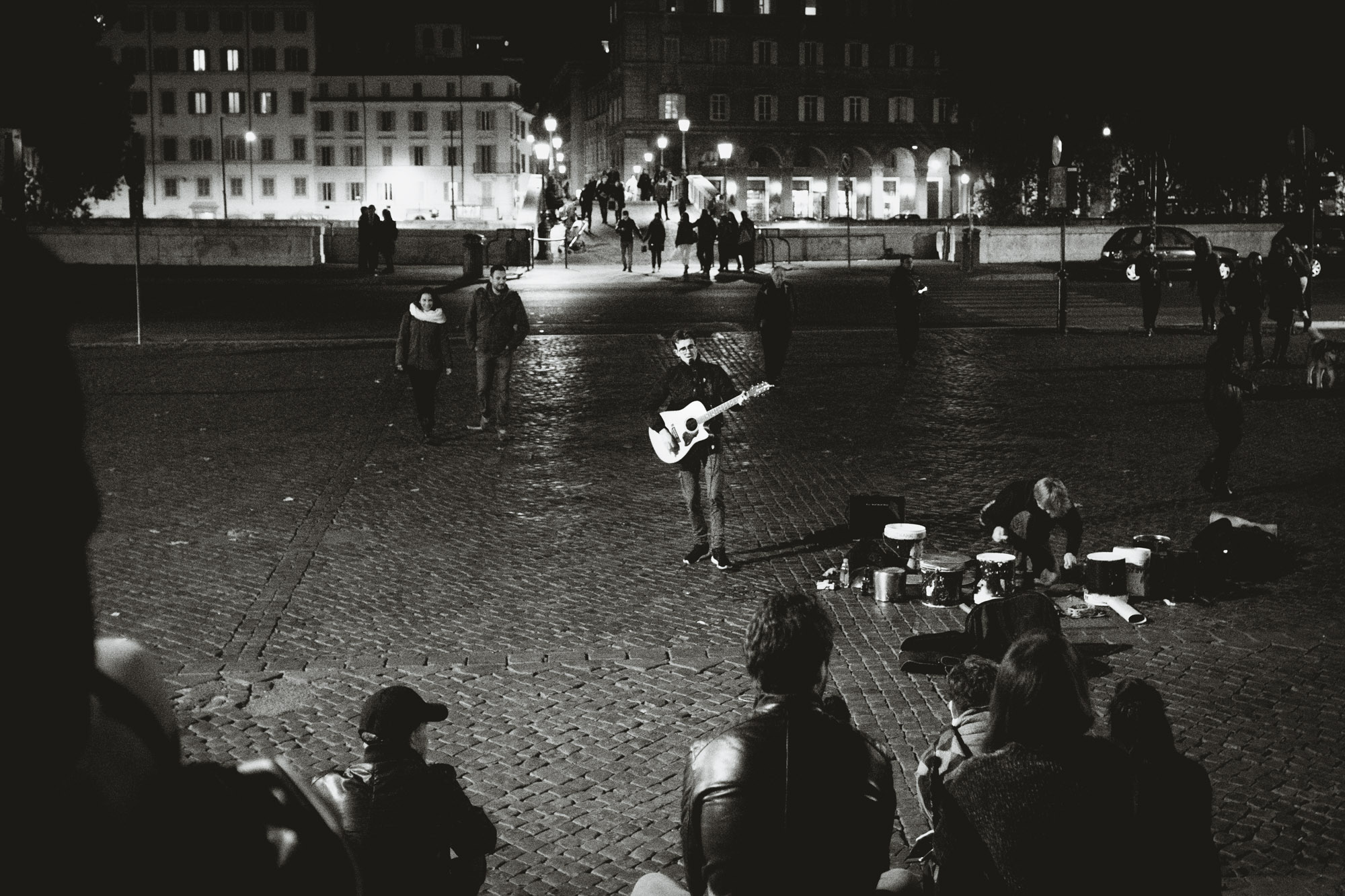 Street musician performing at night at Piazza Trilussa in Trastevere Rome