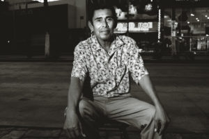 A shopkeeper poses for a portrait outside his shop in Cabo San Lucas