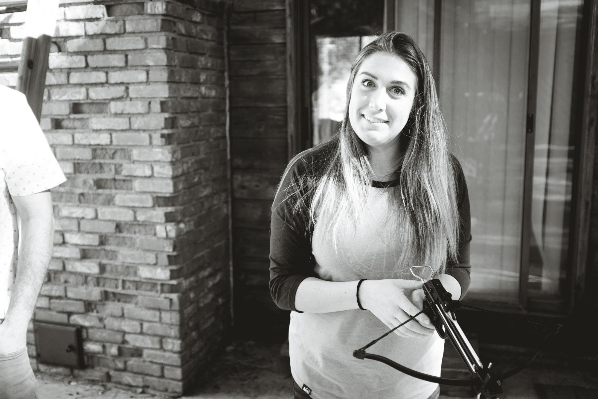 Caitlyn holding a crossbow