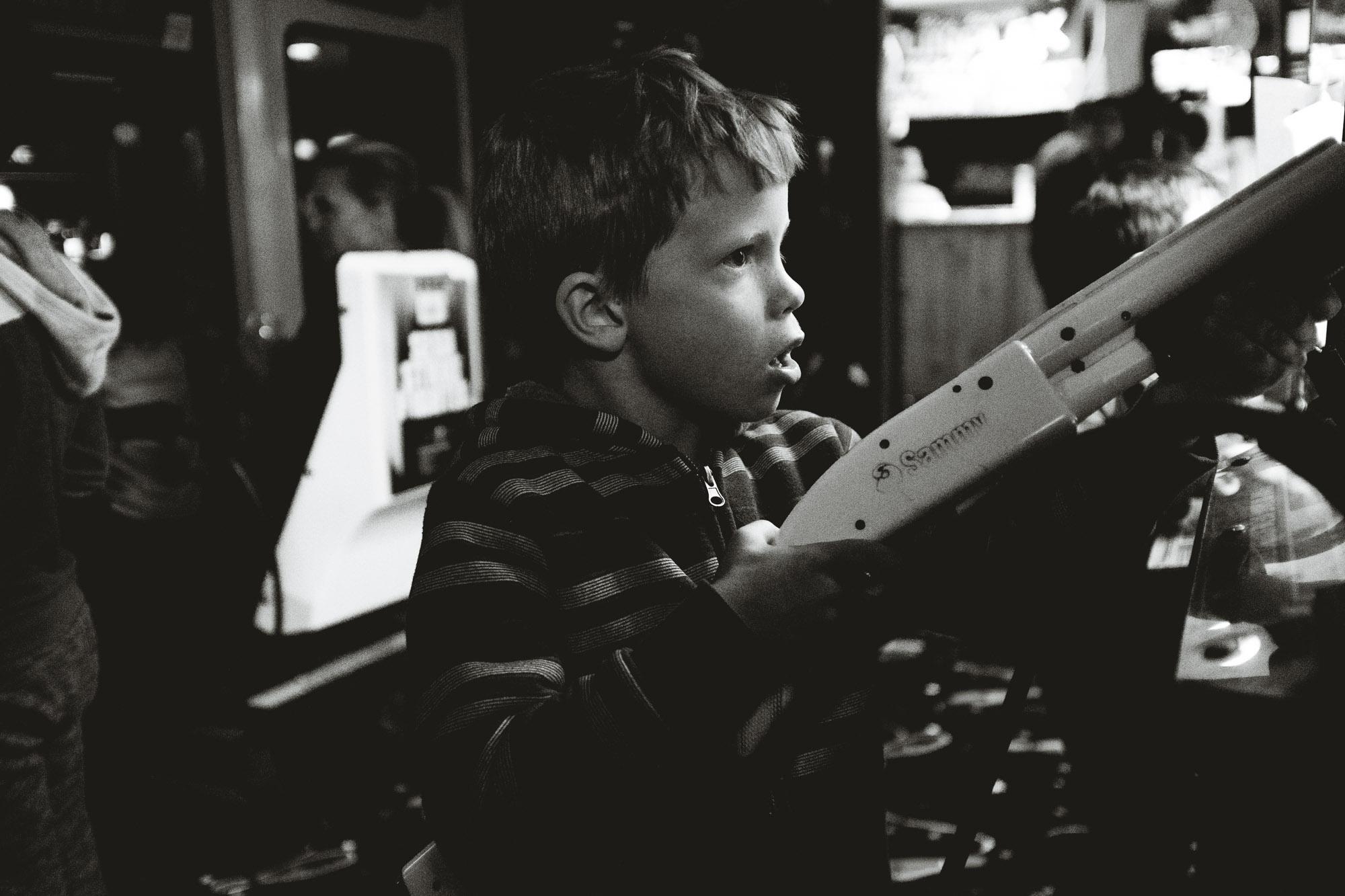 kid playing arcade shooting game in big bear