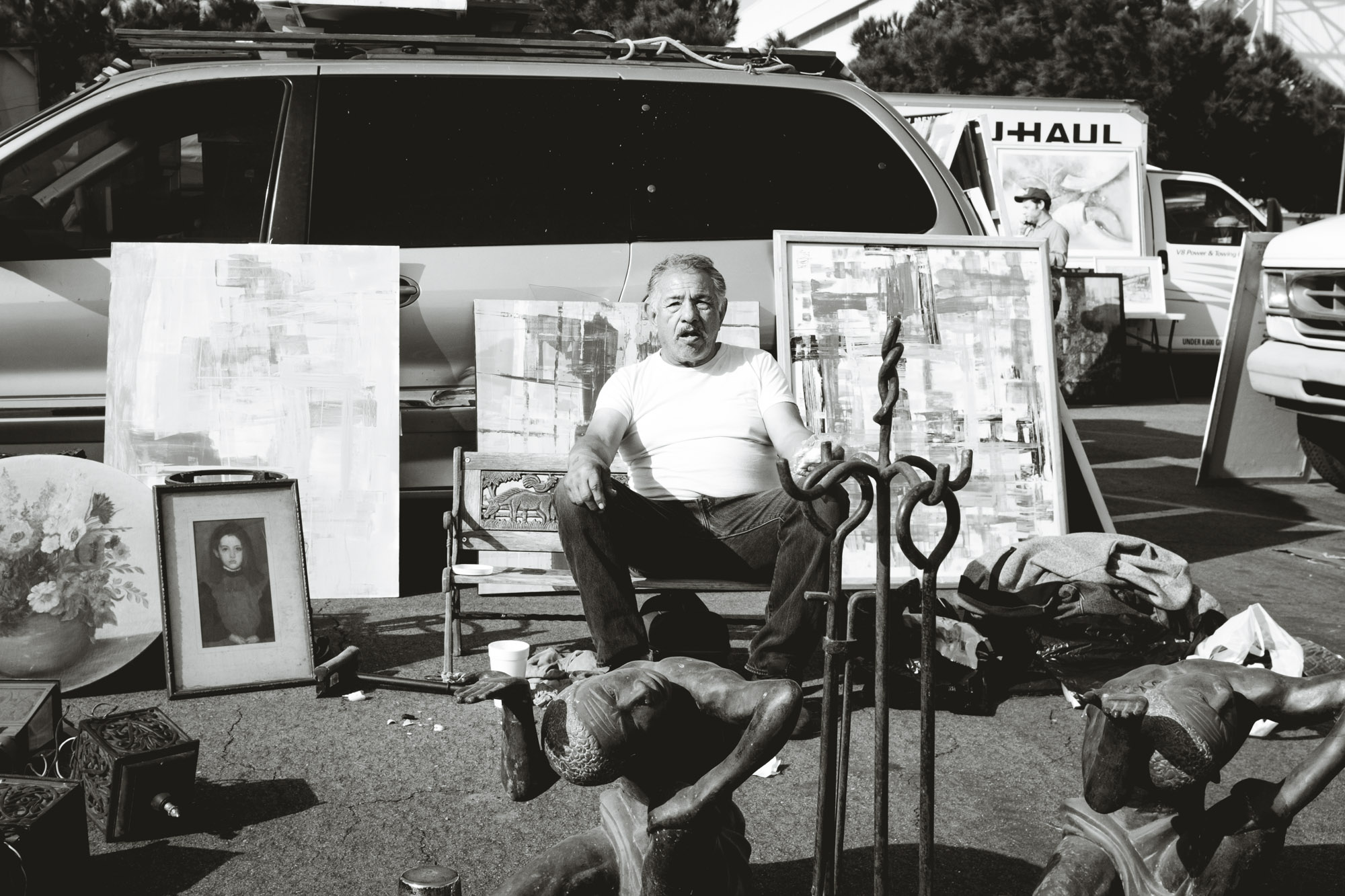 Man sitting at booth at Long Beach Antique Swap Meet