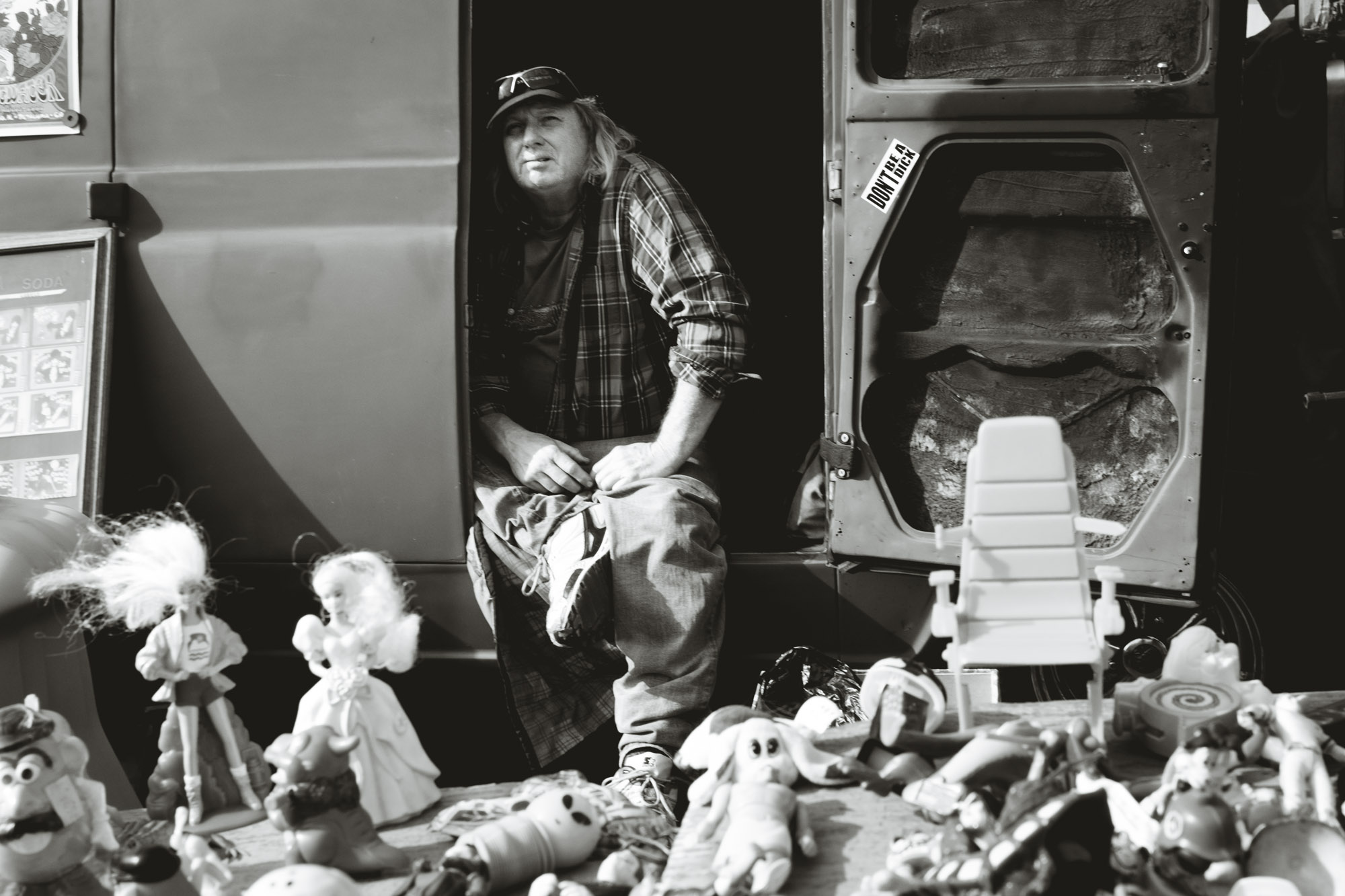 Man sitting in van at Long Beach Antique Swap Meet