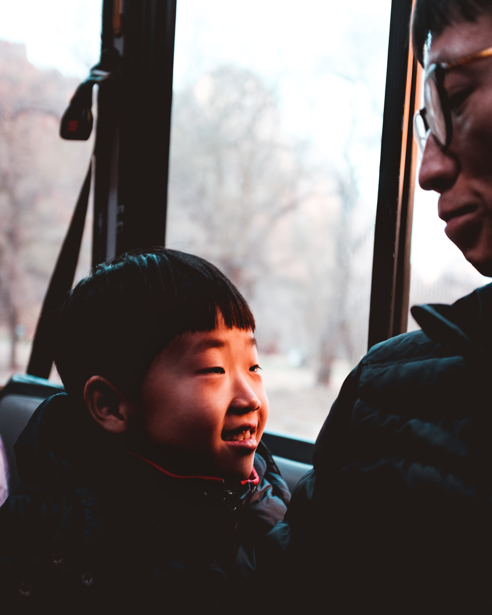 smiling-boy-on-bus-zion-national-park-utah