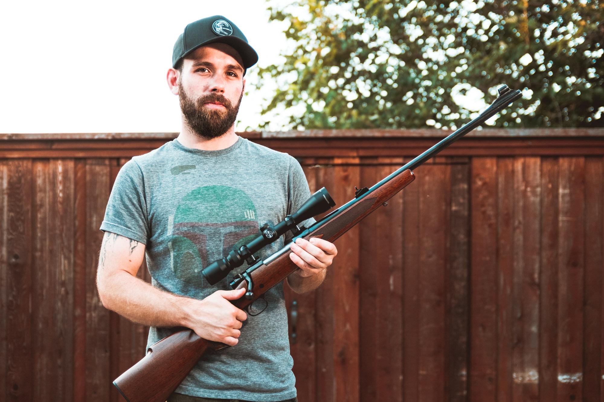 Bob Allard holding a rifle