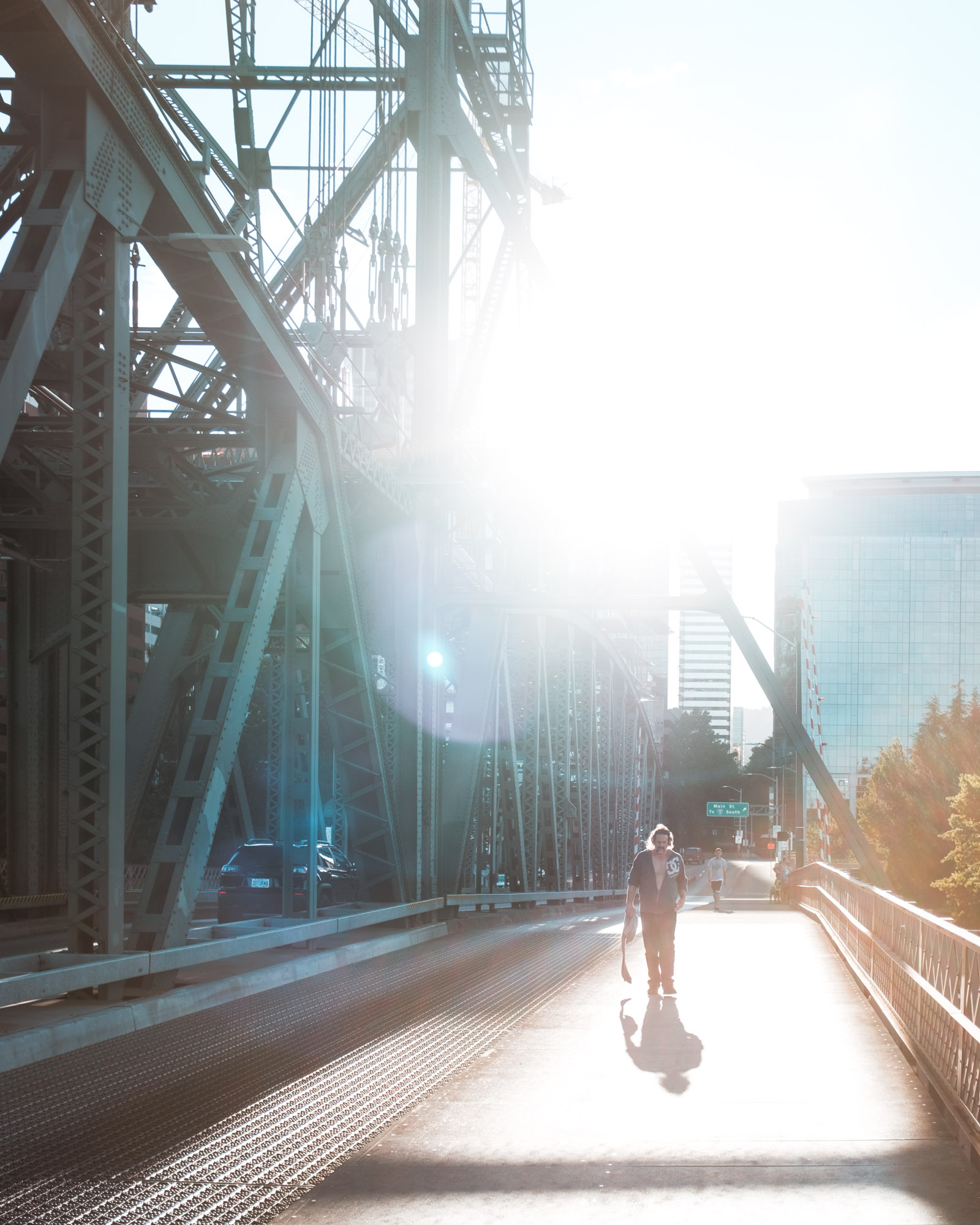 Man-walking-Hawthorne-bridge-Portland-Oregon
