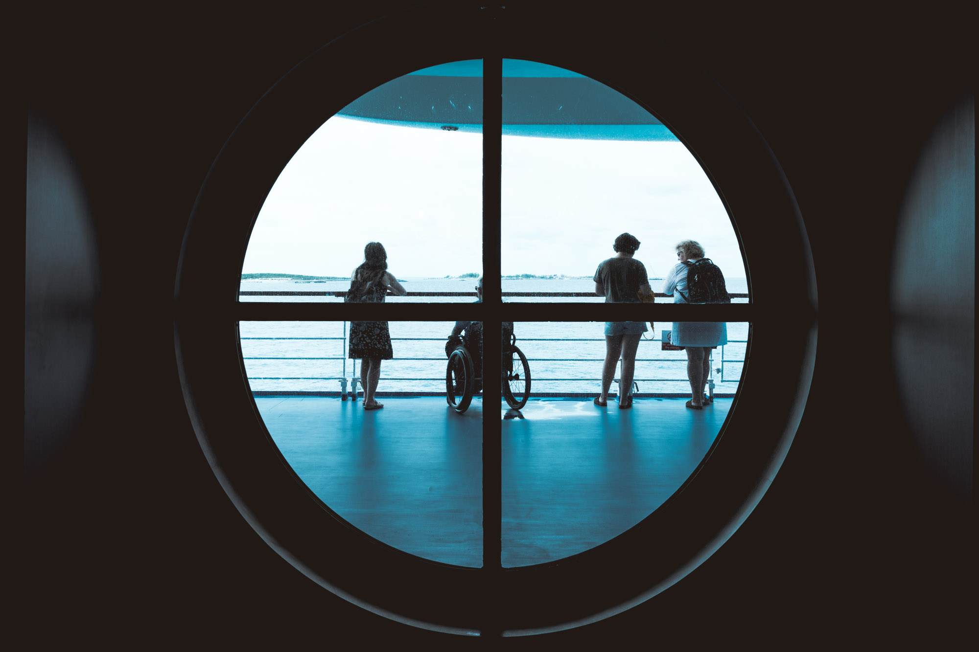 family-wheelchair-through window-norweigan-sky