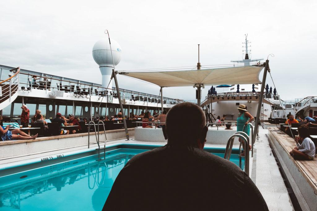 man-sitting-pool-norweigan-sky-cruise-ship