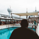 man-sitting-pool-norweigan-sky-cruise-ship