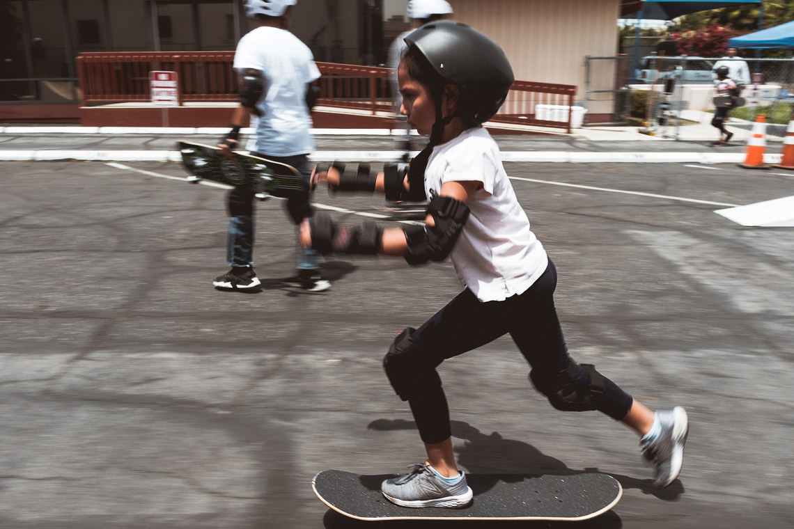 Little girl pushes on her skateboard  during the Skate Fest at the Community Development YMCA.