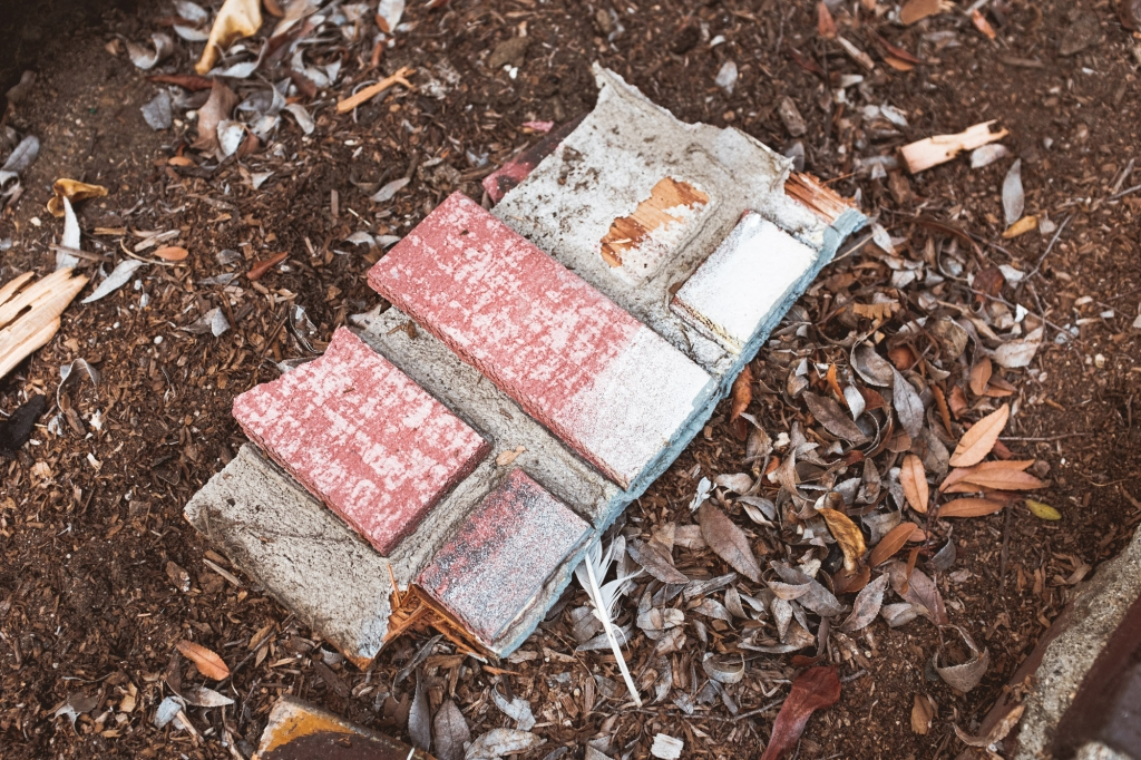 Broken brick facade in dirt in Anaheim CA Colony District