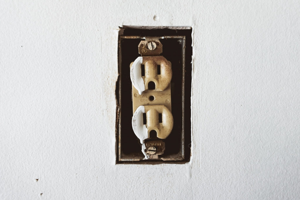 Detail shot of old electrical outlet in garage in Anaheim CA Colony District
