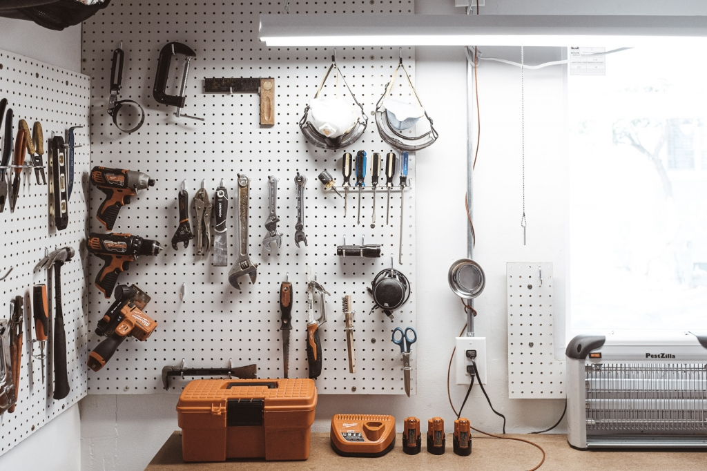 Pegboard and workshop in garage in Anaheim CA Colony District with milwaukee tools